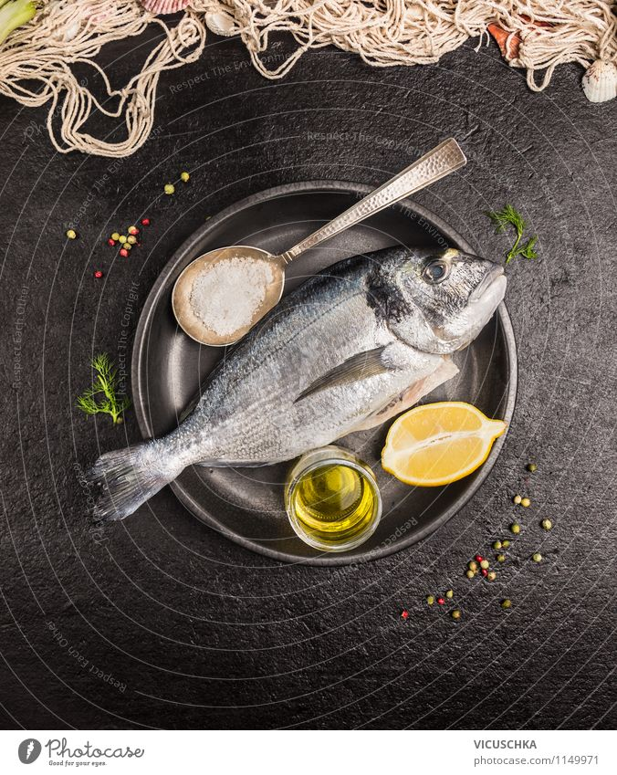 Fish with oil and lemon prepare Food Herbs and spices Cooking oil Nutrition Lunch Dinner Banquet Organic produce Vegetarian diet Diet Plate Bowl Glass Spoon
