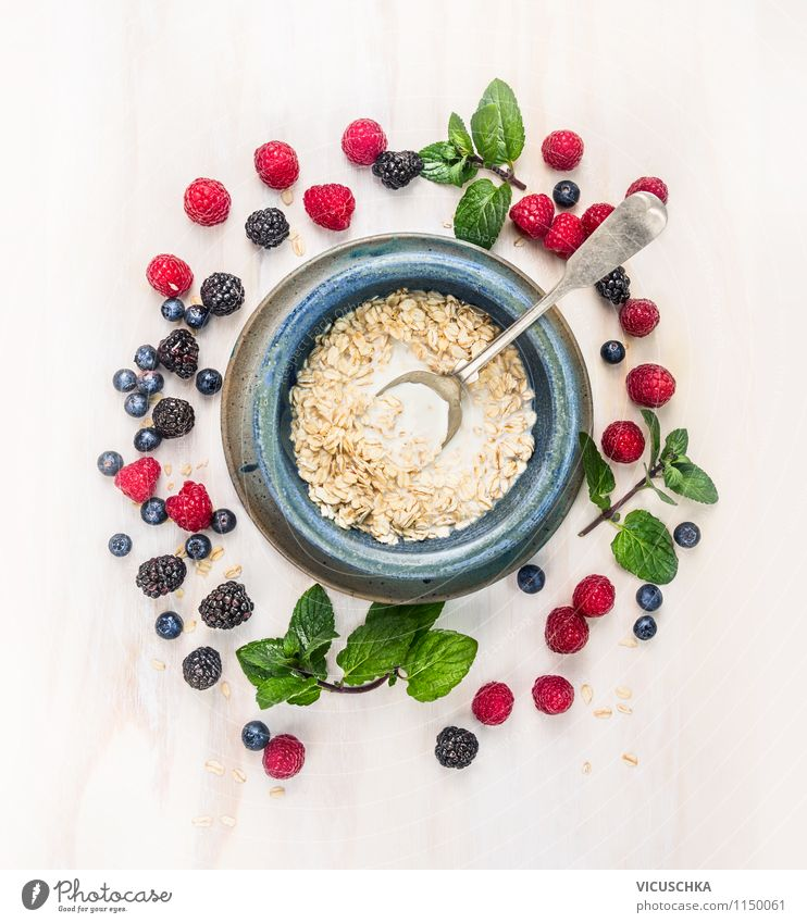 Healthy breakfast - oatmeal with milk and berries Food Dairy Products Fruit Grain Herbs and spices Nutrition Breakfast Organic produce Vegetarian diet Diet Milk