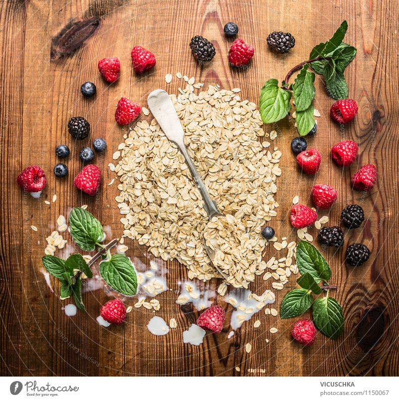 Oat flakes with berries and spoon Food Dairy Products Fruit Grain Dessert Nutrition Breakfast Organic produce Vegetarian diet Diet Milk Spoon Style Design