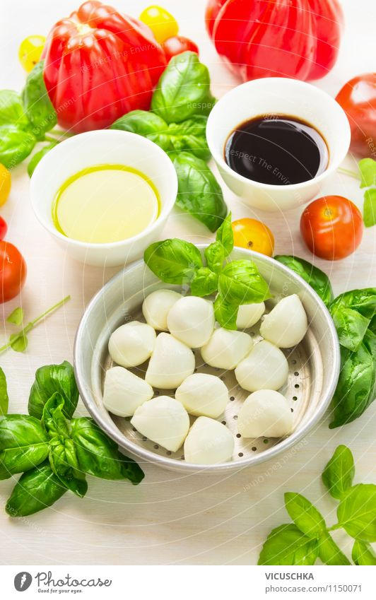 Fresh tomatoes, mozzarella and basil Food Vegetable Lettuce Salad Herbs and spices Cooking oil Lunch Buffet Brunch Picnic Organic produce Vegetarian diet Diet