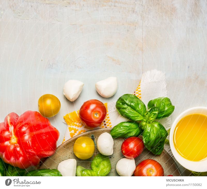 Salad with tomatoes and mozzarella make Food Cheese Vegetable Lettuce Herbs and spices Cooking oil Nutrition Lunch Organic produce Vegetarian diet Diet