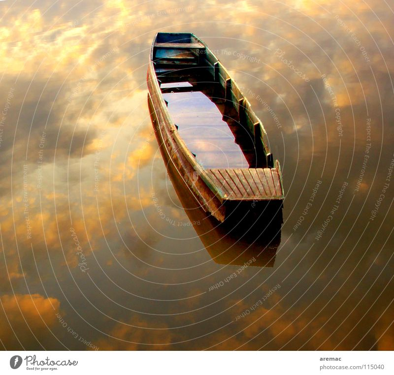 Between heaven and earth Watercraft Calm Loneliness Clouds Navigation reflection Sky