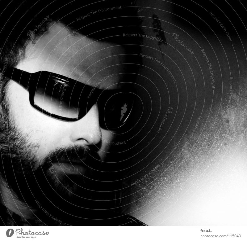 sunglasses Man Eyeglasses Sunglasses Sunlight Attractive Masculine Facial hair Mysterious Portrait photograph Wall (building) Moustache Human being