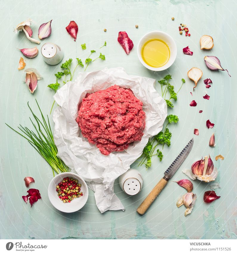 minced meat with oil, herbs and spices Food Meat Vegetable Herbs and spices Cooking oil Nutrition Dinner Banquet Organic produce Diet Bowl Knives Style Design