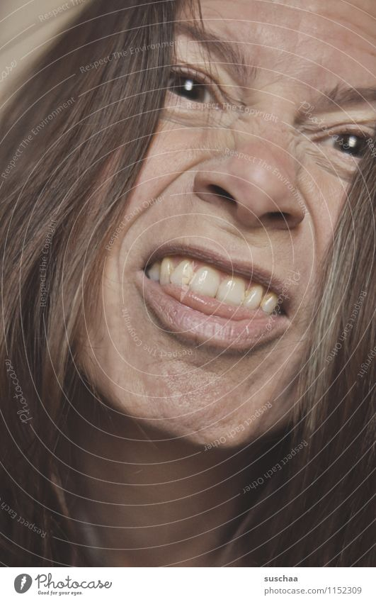 sillier Woman Face Daft Goofy Looking Grimace Eyes Nose Mouth Lips Tongue Teeth Hair and hairstyles Brunette Hideous