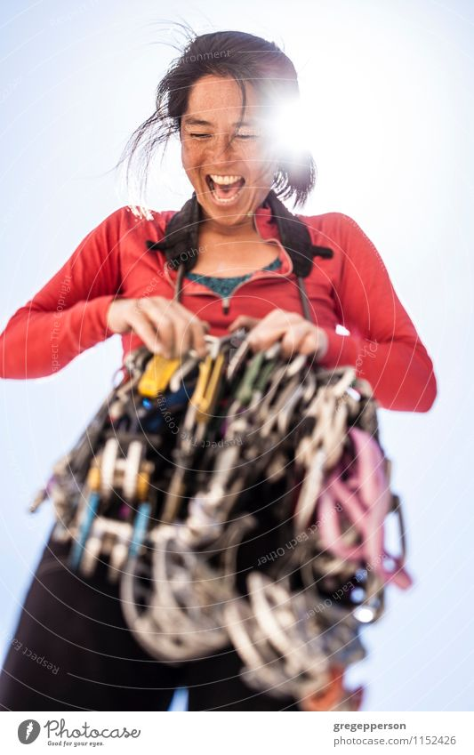 Female rock climber organizing gear. Woman Relaxation Loneliness Adults Rock Power Success Dangerous Adventure Rope Trust Climbing Balance Height Self-confident