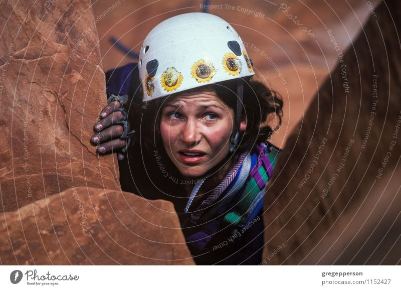 Female rock climber claws towards the summit. Woman Relaxation Adults Rock Power Success Adventure Rope Peak Fear of heights Fear of the future Trust Climbing