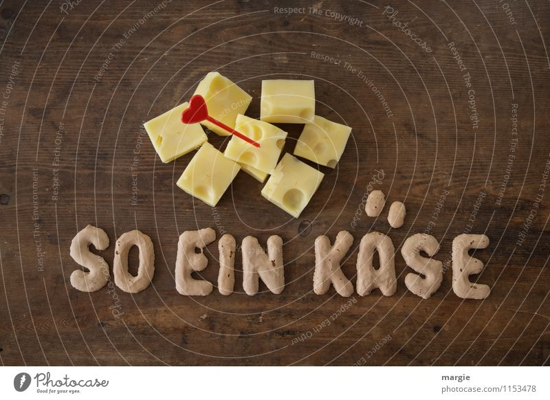 The letters SO A CHEESE on a rustic wooden table with cheese cubes and heart -Pieker Food Cheese Dairy Products Nutrition Breakfast Dinner Picnic