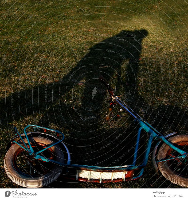 shadow scooter Toys Playing Childhood dream Vintage car Nostalgia Man Green Grass Green space Dream Sporting event Joy Coil Bicycle play fun Human being Lawn
