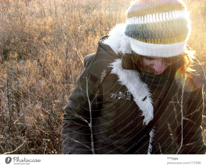winter sun. Back-light Woman Cold Winter Cap Portrait photograph Freeze Field Brown Jacket Ice Think Pampa Pelt Coat Blade of grass Timidity
