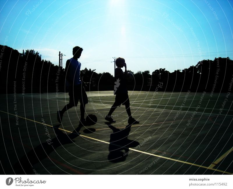 summerlife Colour photo Exterior shot Shadow Silhouette Leisure and hobbies Playing Summer Sportsperson Soccer Foot ball Ball Sporting Complex Sporting grounds