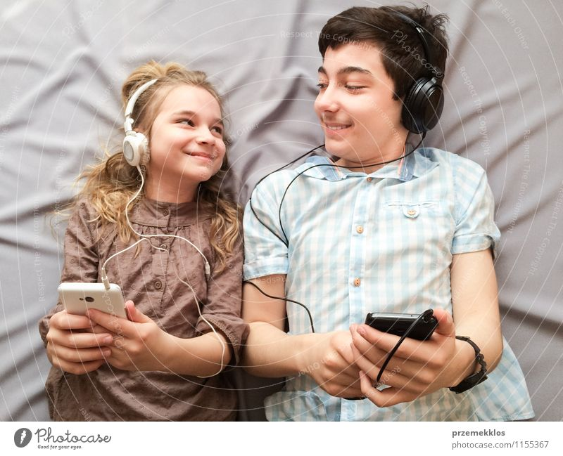 Top shot of brother and sister listening to music together from smartphones Joy Happy Music Girl Boy (child) Brothers and sisters Sister Family & Relations 2