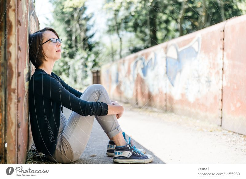 Young woman sitting leaning against a wall in the shade Lifestyle Style Leisure and hobbies Freedom Human being Feminine Youth (Young adults) Adults 1