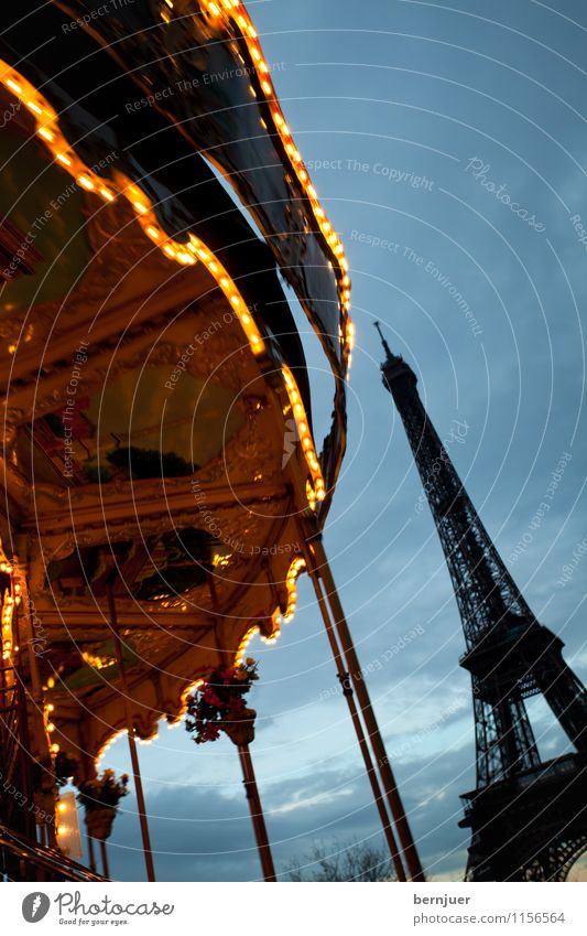 merry-go-round Town Capital city Tourist Attraction Monument Eiffel Tower Rotate Famousness Blue Gold Contentment Carousel Light Movement Paris Clouds Sky