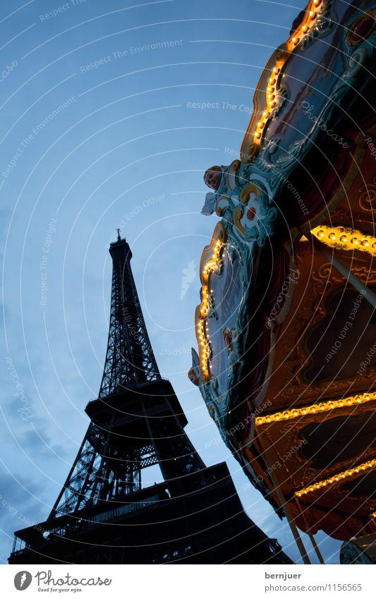 Blue Yellow Travel photography Lighting Tourism Uniqueness Tower Landmark Steel Tourist Attraction Paris France Illumination Blue sky Carousel Eiffel Tower