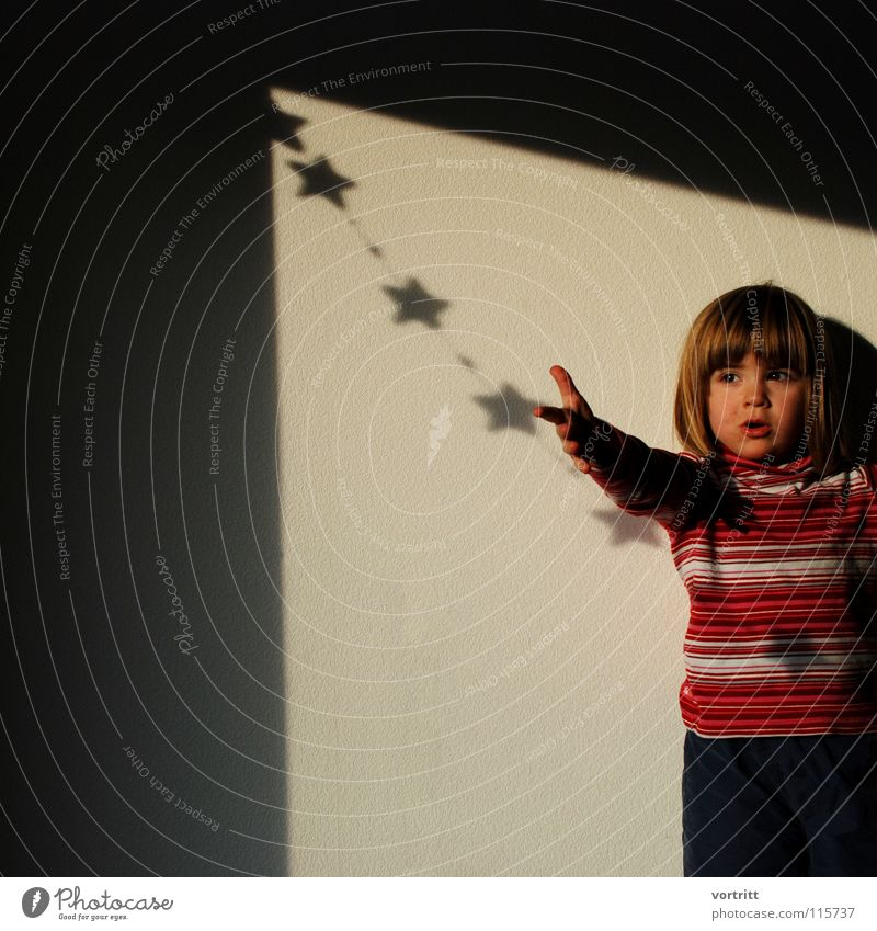 christmas child Child Girl Portrait photograph Emotions Christ child Christmas & Advent Star (Symbol) To hold on Lamp Shadow Catch Moon Tradition