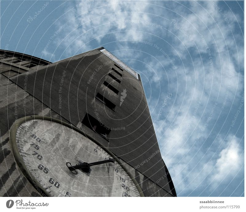 untimeliness Gasometer Clock face Building Derelict Dresden Gray Clouds Industrial construction Detail Industry Clock hand Sky Level Old