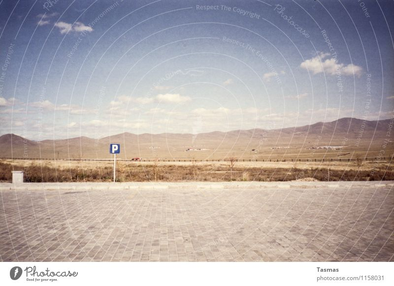 [P] Landscape Elements Earth Sand Sky Clouds Hill Mountain Sign Characters Signs and labeling Beginning Parking lot Places Mongolia Desert Colour photo