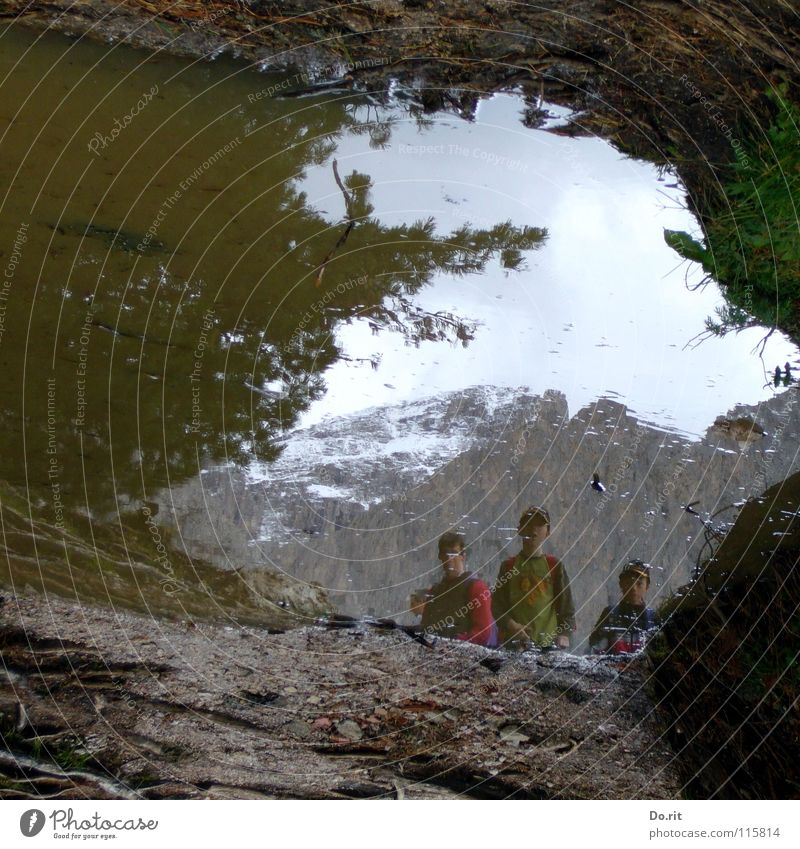 Human being Child Water Sky Clouds Dark Snow Grass Mountain Gray Planning Rock Italy Mirror Peak Tunnel
