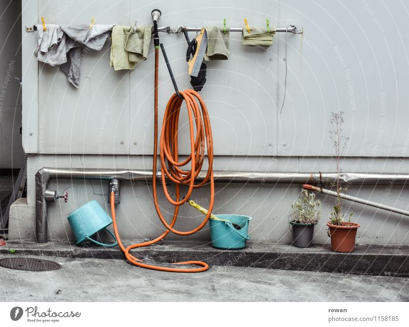 washing place Facade Town Cleaning Car wash Iron-pipe Tap Water Dry Towel Floor cloth Hang up Bucket Colour photo Exterior shot Deserted Day