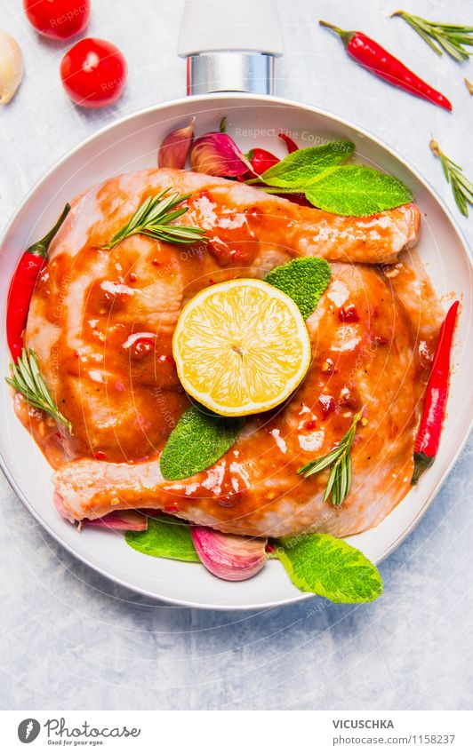 Hot chicken legs with lemon and sage Food Meat Herbs and spices Cooking oil Lunch Banquet Organic produce Diet Pan Style Design Healthy Eating Life Table