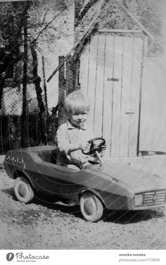 racing driver Black Fence House (Residential Structure) Child Human being Racing driver Car Boy (child) wise fence door Wheel