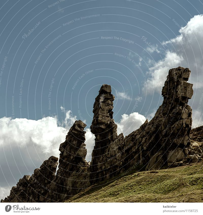 Trinity Vacation & Travel Tourism Trip Mountain Nature Landscape Sky Clouds Spring Beautiful weather Grass Rock Old Threat Sharp-edged Blue Yellow Teufelsmauer