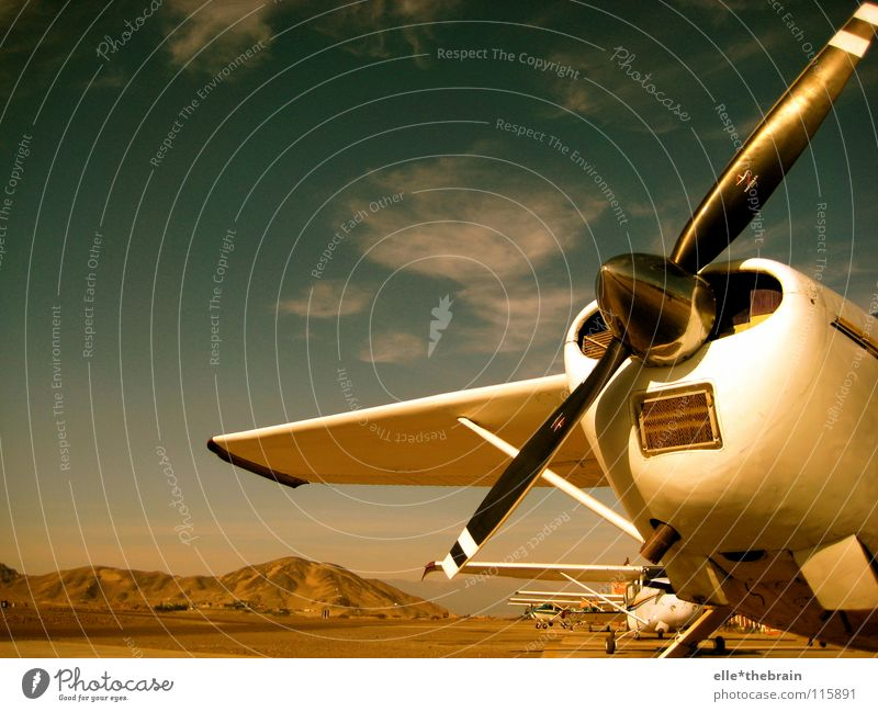 Vacation & Travel Far-off places Relaxation Airplane Flying Leisure and hobbies Desert Machinery Propeller