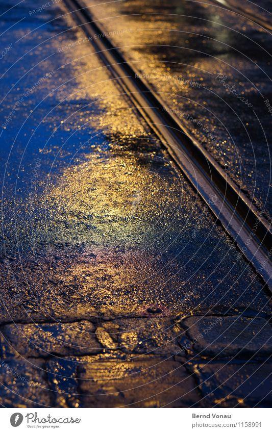 FR UT | Moist cheerful Transport Public transit Crossroads Blue Yellow Black Rail transport Dark Cobblestones Metal Wet Rainwater Tilt Asphalt Line Perspective