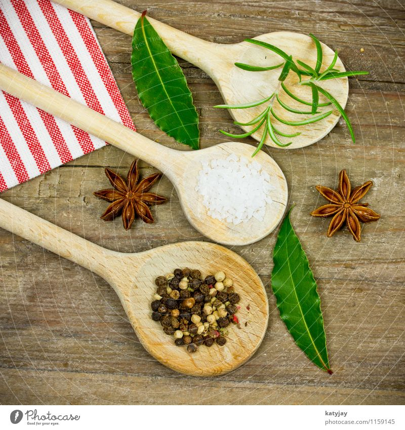 spices Herbs and spices Pepper Wooden spoon Peppercorn Rosemary Cooking sea salt Star aniseed Kitchen Ingredients Country house Table Wooden table Near Close-up