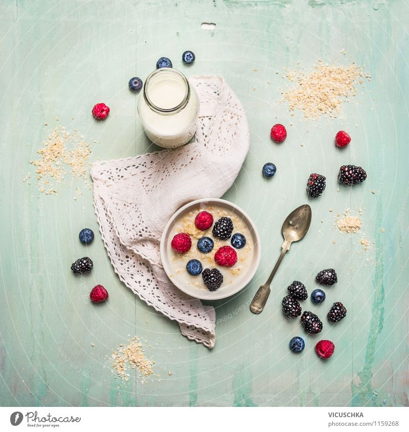 Breakfast with oat bran, milk and berries Food Dairy Products Fruit Grain Nutrition Organic produce Vegetarian diet Diet Beverage Milk Crockery Plate Bowl