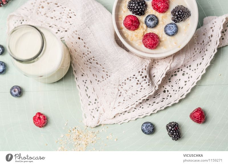 Oat porridge with milk and berries Food Dairy Products Fruit Grain Nutrition Breakfast Organic produce Vegetarian diet Diet Beverage Milk Bowl Life Summer
