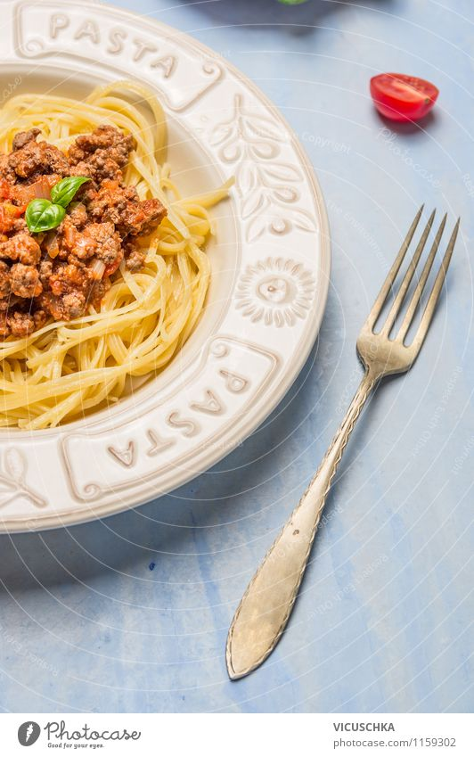Spaghetti Bolognese in plate with fork Food Meat Vegetable Dough Baked goods Herbs and spices Nutrition Lunch Banquet Organic produce Diet Italian Food Crockery