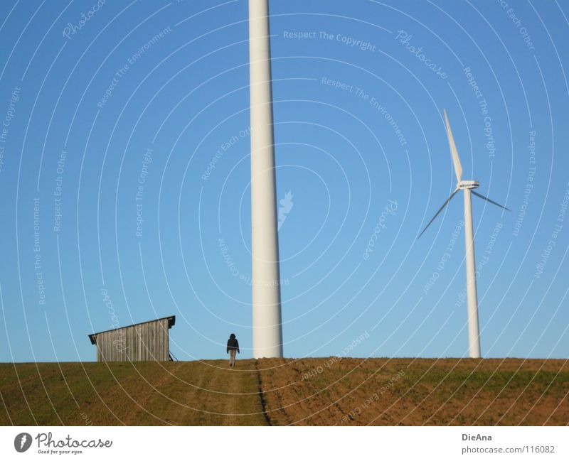 phenomenal Renewable energy Winter December Field Cold Colossus Gap Sky blue Small Loneliness Diminutive Woman To go for a walk Rotate Calm Energy industry
