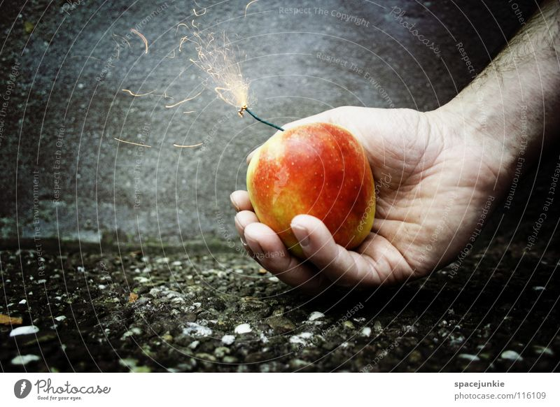 Hand Joy Nutrition Wall (building) Healthy Eating Fruit Concrete Fresh Dangerous Threat New Year's Eve Apple Force Firecracker Whimsical