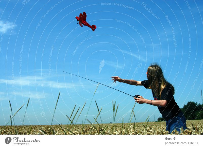 Human being Sky Youth (Young adults) Blue Red Joy Playing Movement Air Blonde Gold Dynamics Cornfield Snapshot Throw Departure