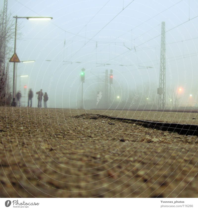 Human being Old Blue Joy Winter Vacation & Travel Loneliness Far-off places Cold Group Wait Fog Time Railroad Stairs Driving