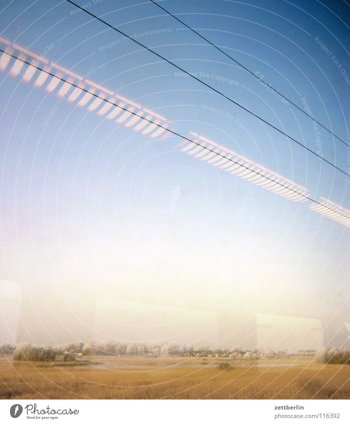 Rail journey to the north 5 Tree Bushes Winter Immature Railroad Train window Overhead line Light Lamp Reflection Driving Passage Transport Landscape Sky