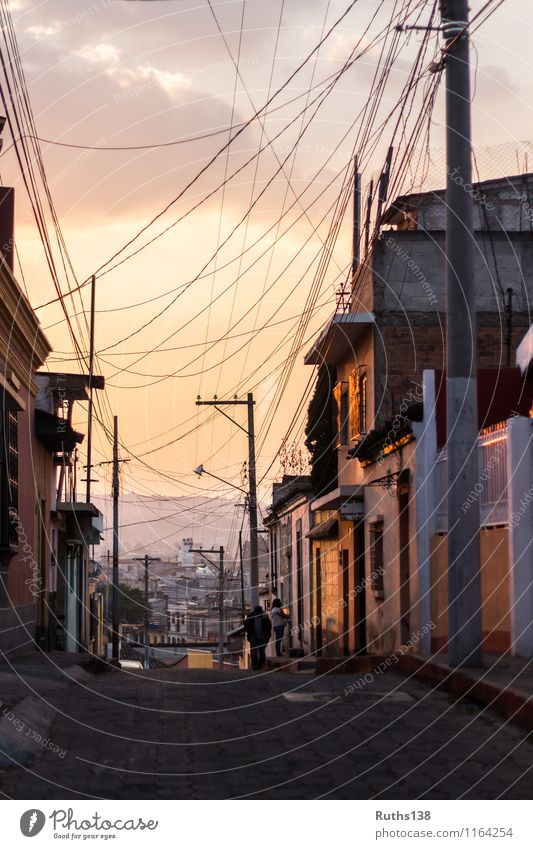 Sunset in a typical street of Xela in Guatemala Town Populated House (Residential Structure) Wall (barrier) Wall (building) Street Far-off places Gold Orange