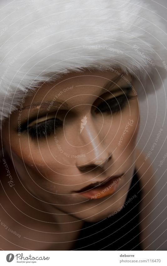 Close up portrait of a female shop mannequin with a Christmas Santa hat on her head. Woman Human being Mannequin False Fraud Model Decoration Christmas & Advent