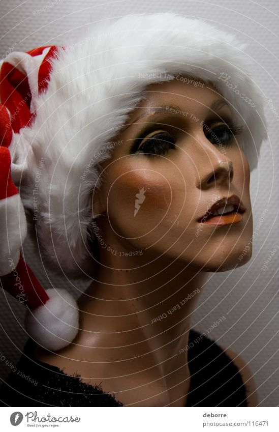 Portrait of a female shop mannequin with a Christmas Santa hat on her head. Woman Human being Mannequin False Fraud Model Decoration Christmas & Advent huge