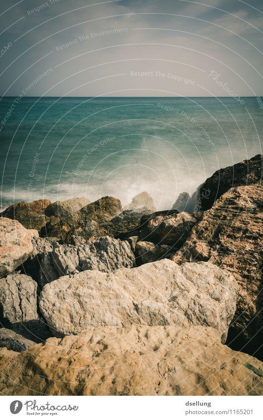 Rocky coast by the sea Elements Romance Reflection Light (Natural Phenomenon) Sunbeam Colour photo Swell Green Blue Sky Stone rocky coast Spain denia