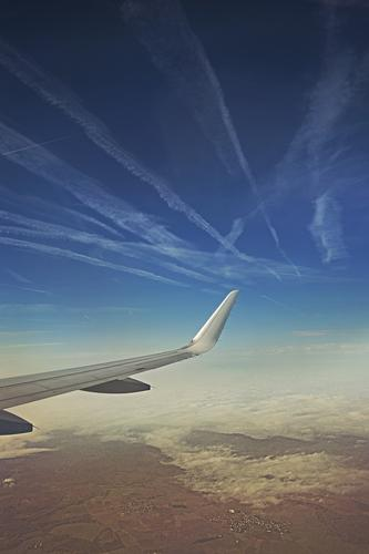 Sky Vacation & Travel Blue White Landscape Clouds Far-off places Environment Gray Freedom Flying Brown Line Horizon Tourism Aviation
