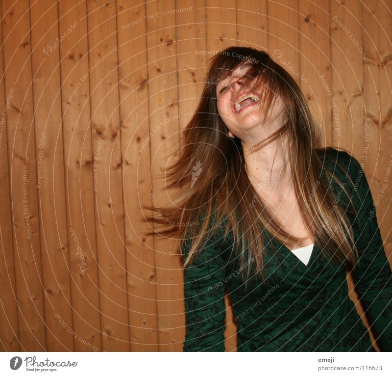 laughing flash Woman Youth (Young adults) Rocking out Party Authentic Wooden wall Air Breeze Beautiful Sweet Beauty Photography To enjoy Good mood Movement