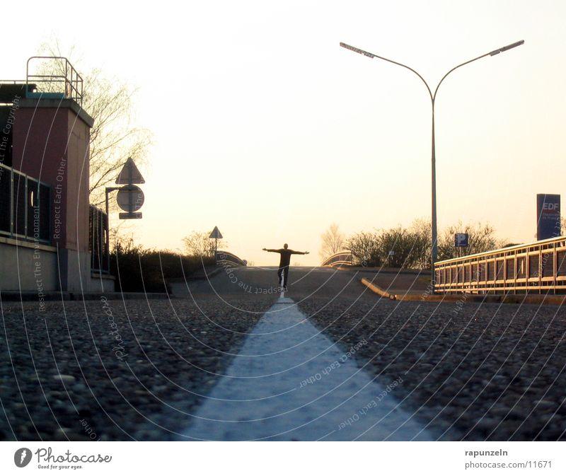 How many roads must a man go down? 1 Asphalt Median strip Man Transport Street Escape Silhouette