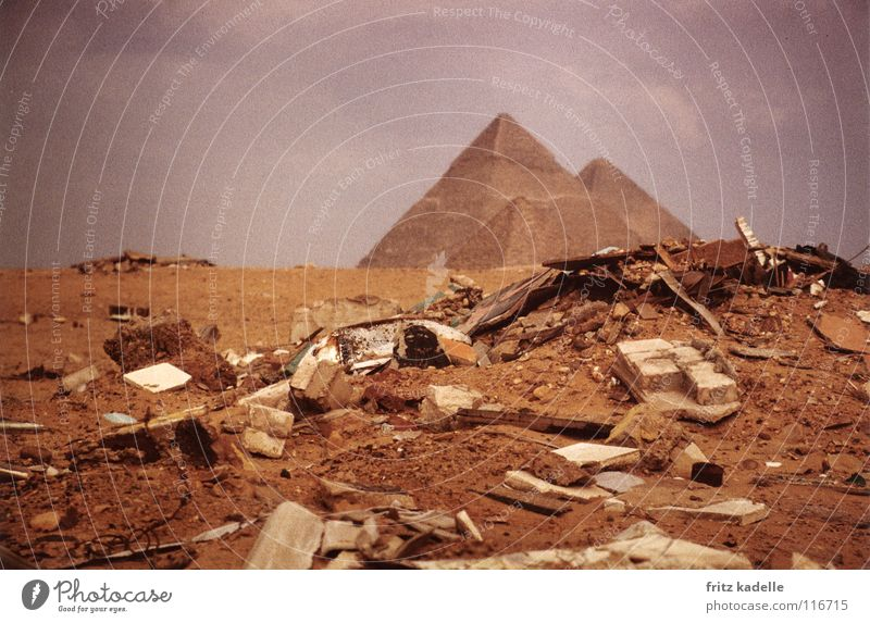 small mountain of rubbish at the big pyramid Giza Egypt Trash Heap Bad weather Desert Africa Pyramid crisis Clouds Sand the Great Pyramid