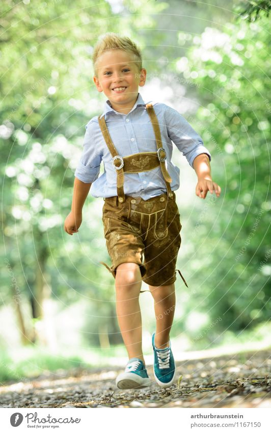 Blond boy in traditional costume Joy Athletic Playing Vacation & Travel Tourism Trip Summer Summer vacation Human being Masculine Child Boy (child) Infancy 1