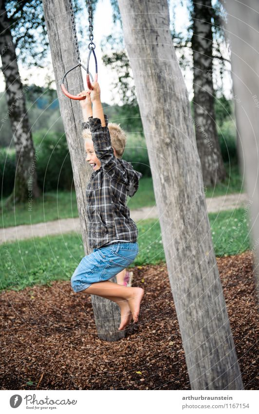 Boy swinging with rings Athletic Leisure and hobbies Playing Playground Circle Vacation & Travel Tourism Trip Summer Summer vacation Garden Fitness