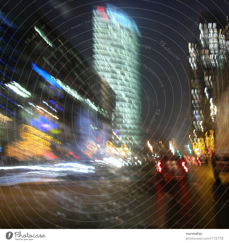 Quickly eastbound Night Town Places Middle Wall (barrier) Marketplace New building High-rise Driving Drops of water Agitated Windscreen Carriage Rear light