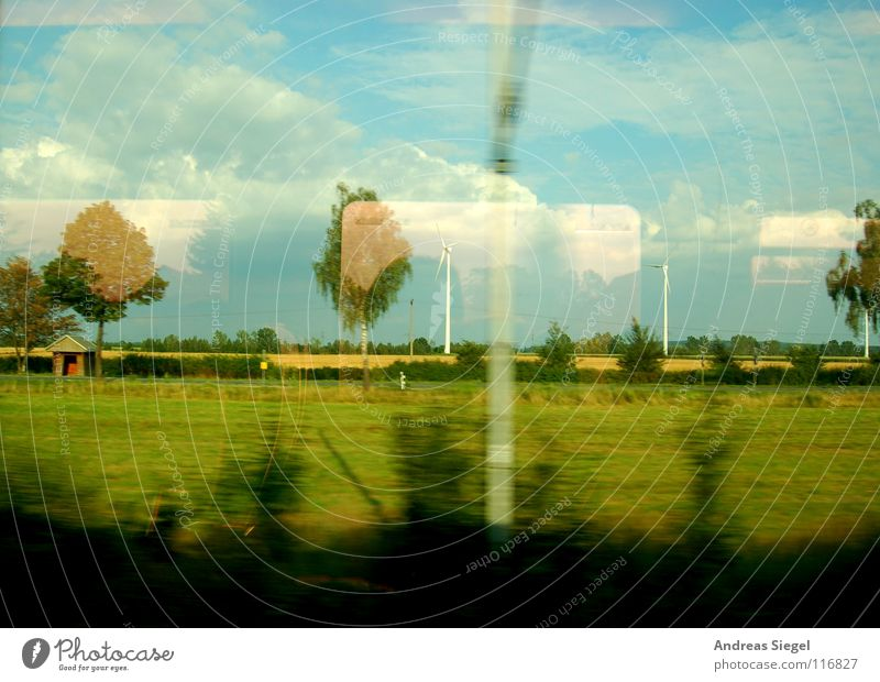 A train ride, etc. Driving Train travel Window Looking Boredom Roll Electricity Overhead line Danger of Life Reflection Tree Clouds Field Meadow Bushes Speed